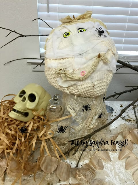 The cutest handmade Mummy made from old cloth shower curtain and tie-dyed ribbons and gauze wrap