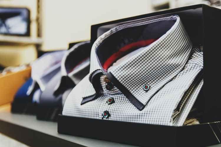 selective focus photography white button up collared top