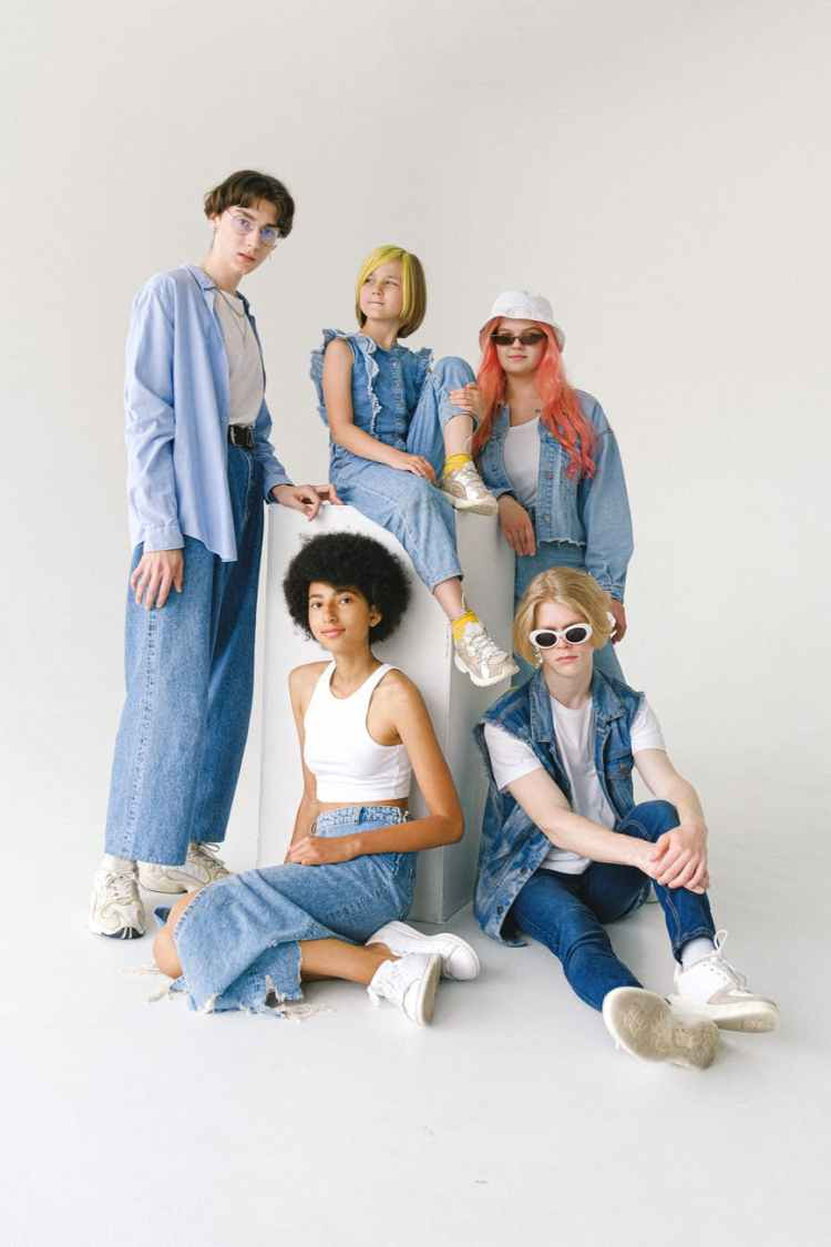 group of multiethnic models demonstrating casual denim outfits