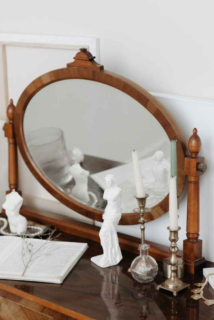brown wooden framed mirror on brown wooden table