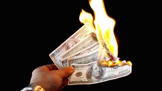 dollar-on-fire