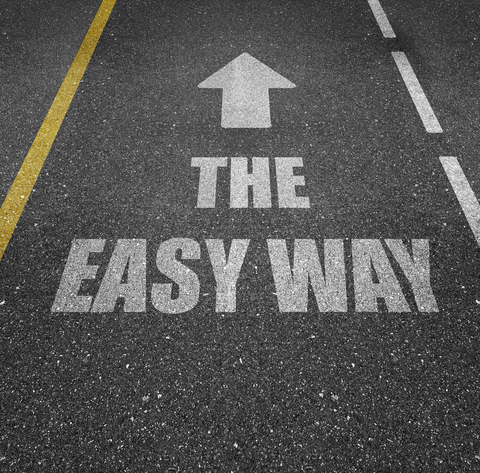 "A highway with the Words ""The easy way"" and an arrow pointing up"