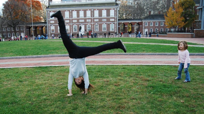 Woman doing a cartwheel in the park