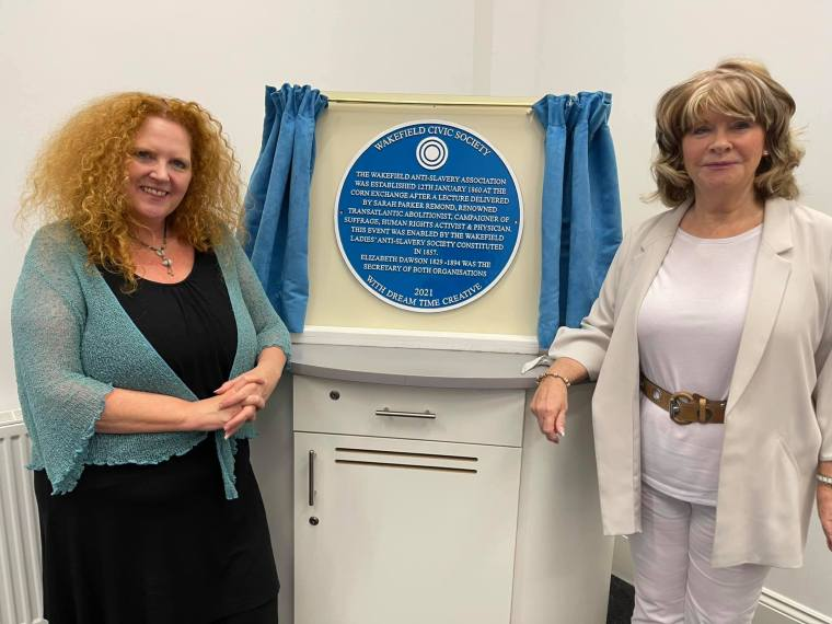 Project leader Sarah Cobham stands by a newly unveiled blue plaque to Elizabeth Dawson and Sarah Parker Remond.