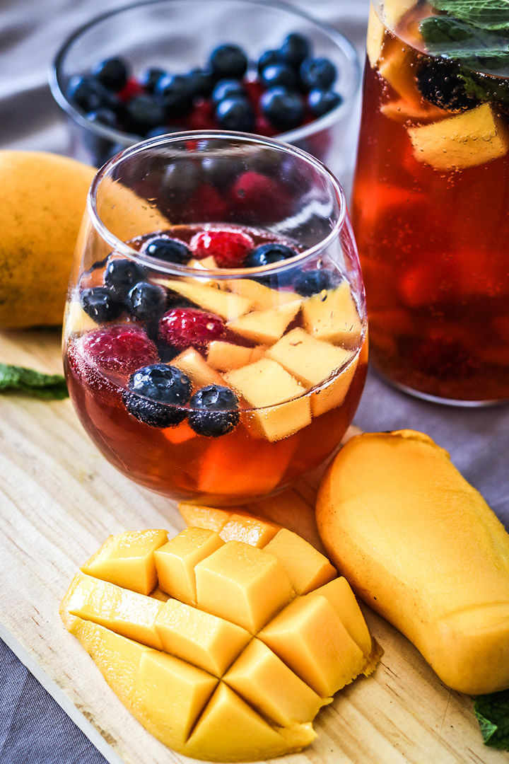 Take advantage of rosé season with this Mango Berry Rosé Sangria. Sparkling pink rosé, mangos, berries and brandy - perfect for your next summer soirée!
