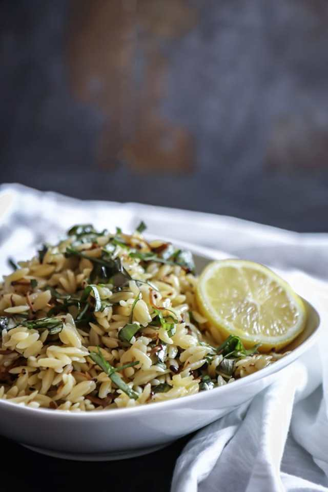 Vegan Mushroom Orzo Salad with enoki, fresh basil and drizzled in black truffle oil. Served warm or cold this vegan pasta salad is comfort food at its best!
