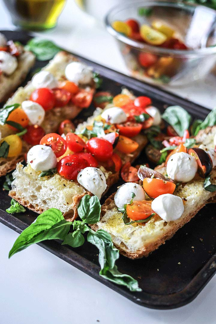 Caprese Ciabatta Toast, an easy dinner of ciabatta bread with a fresh caprese salad on top!