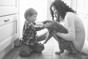 mom hold cat toddler pets foster for kitty's sake