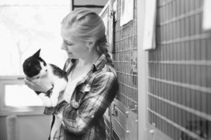 woman adopting cat from shelter for kitty's sake