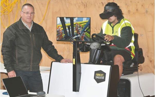 Andrew Stone overseeing VR Forklift-Simulator training