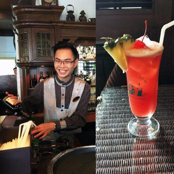 Bar tender and glass of Singapore Sling in Singapore-Dining capital of Asia