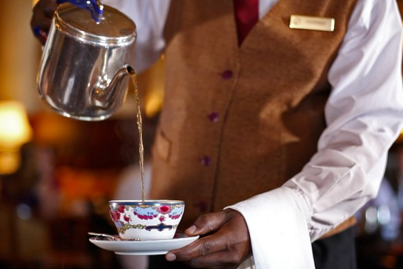 man pouring tea - Have a cuppa- its tea time