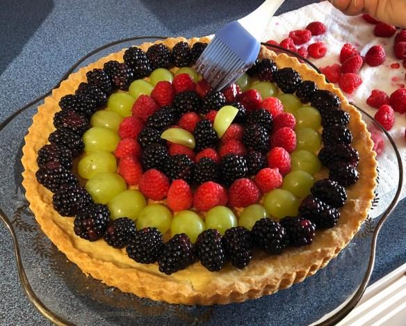 Brushing glaze on fruit