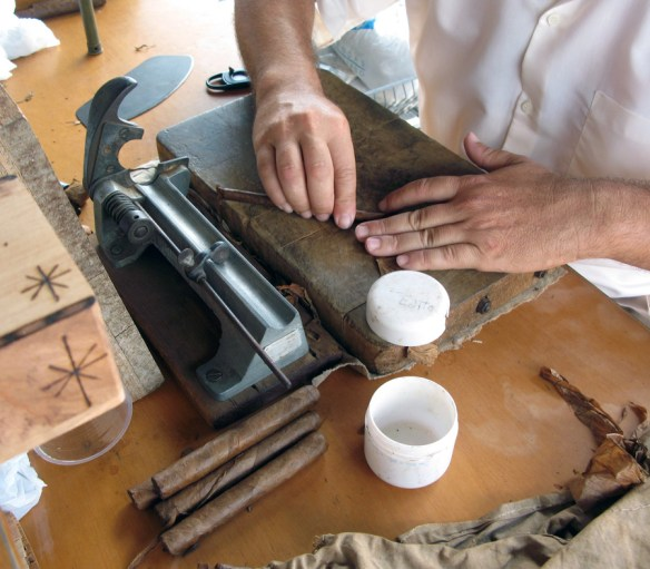 man rolling a cigar - The Perfect Cigar -Cuba's Gift to the World