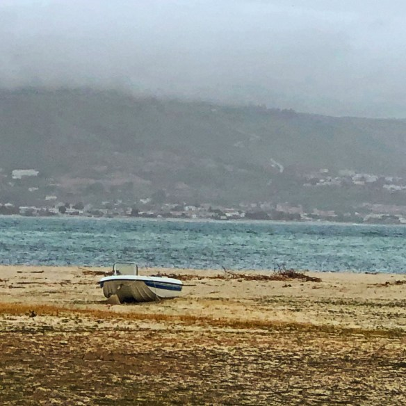 beach with boat in foreground