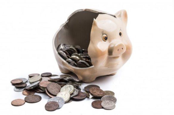 broken piggy bank and coins