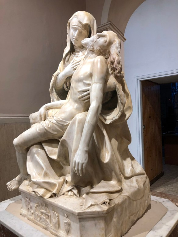 sculpture of a pieta - Mary holds her dead son, Jesus in her arms