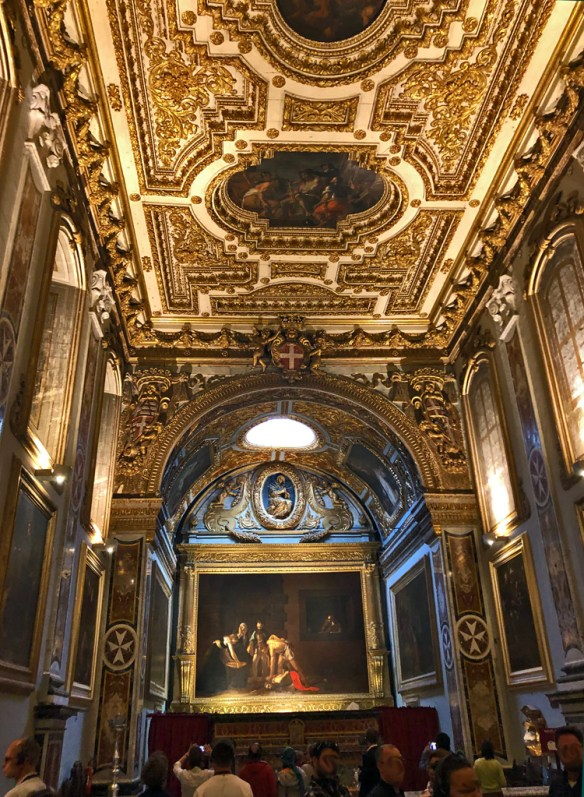Ornate oratory of the church with the painting by Carravaggio on display