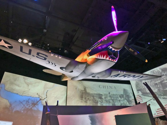 US airplane painted like a shark hanging in the WW II Museum