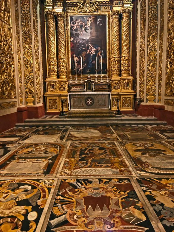 Gold altar and beautiful marble floor tombs