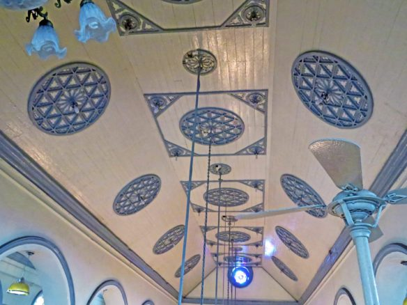 blue and white ceiling is decorated with Star of David motifs
