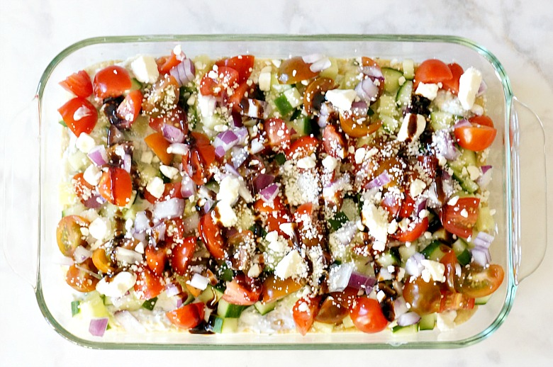 Make your own or use prepared hummus and you'll be the star of your next potluck with this Greek Seven Layer Dip! It's fresh, healthy and bursting with mediterranean flavors!