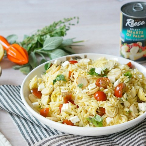 Spruce up your basic pasta salad! Our recipe for Orzo Salad introduces hearts of palm and artichoke hearts to this potluck favorite. Panfrying the veggies first lends great color and flavor!