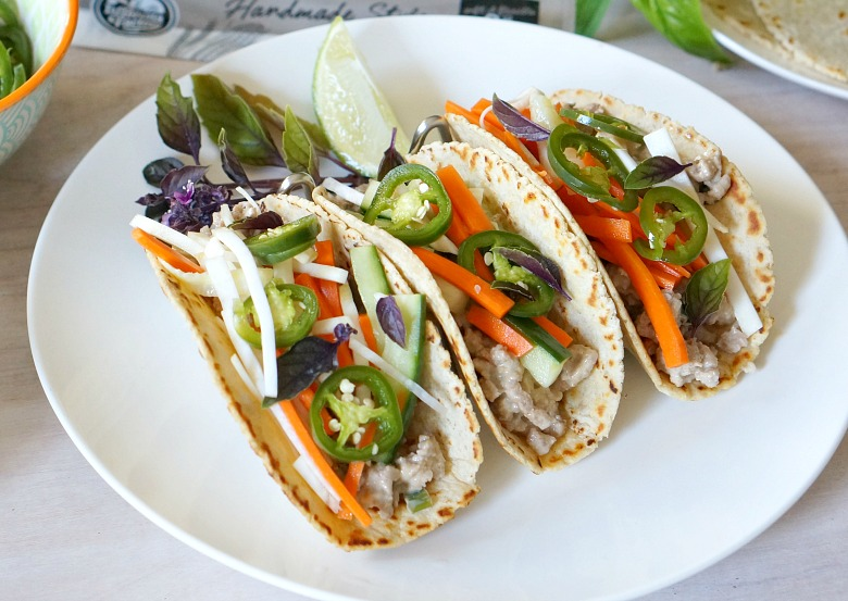 The traditional Vietnamese Banh Mi sandwich meats taco night in these Banh Mi Style Pork Tacos! Easy to make and bright with flavor, you'll want to make every night Taco Tuesday!