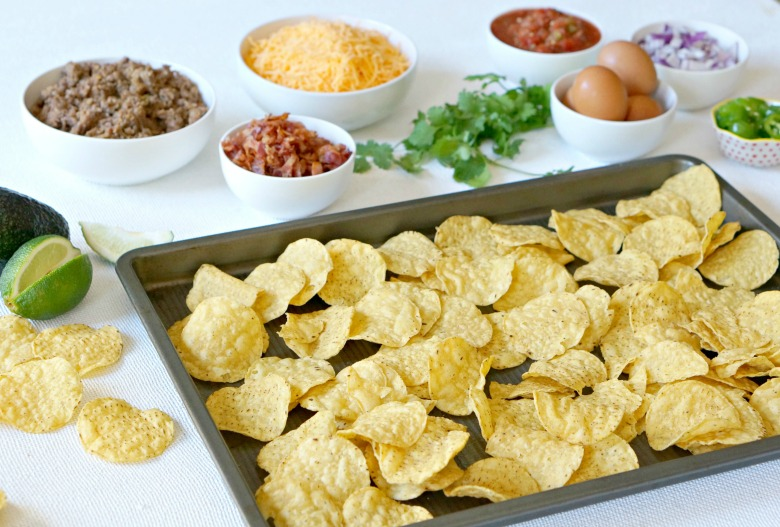 This Sausage, Bacon, & Egg Breakfast Nachos recipe is life changing. Spicy sausage. Crispy bacon. Sunny side up eggs. Lots of cheese. And crisp Mission® Rounds Tortilla Chips. Serve this to your crew, and you'll fast become a breakfast celebrity.