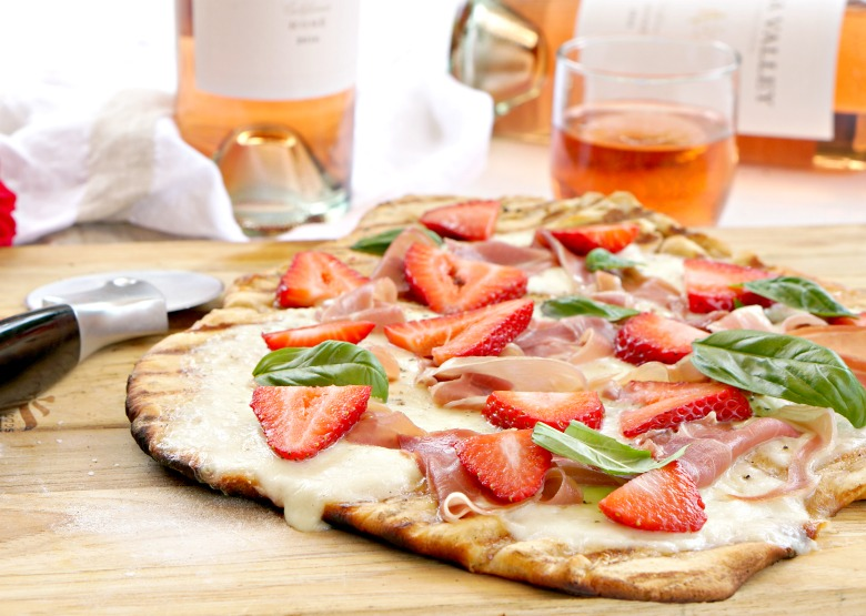 Grab your favorite Rosé to enjoy with our Prosciutto and Strawberry Grilled Flatbread.  Served as an appetizer or light supper, our Prosciutto and Strawberry Grilled Flatbread is the perfect complement to your summer soirée