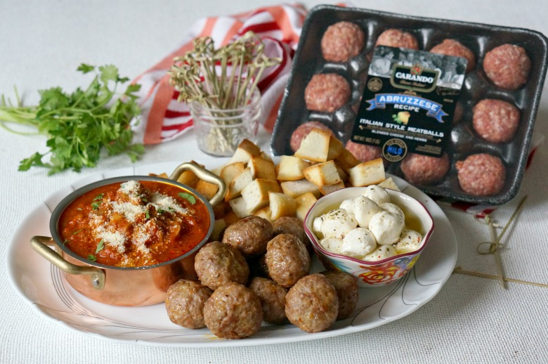 Our Abruzzese Meatball Appetizer Platter is both convenient and satisfying! With homemade marinated mozzarella, your favorite marinara and Carando® meatballs, this dish will be the biggest hit of any holiday party!