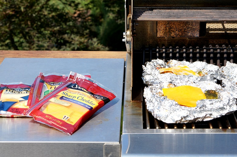 Easy. Tasty. Ooey-Gooey. These Cheesy Chicken and Veggie Foil Packets are your answer to comfort food from the grill.