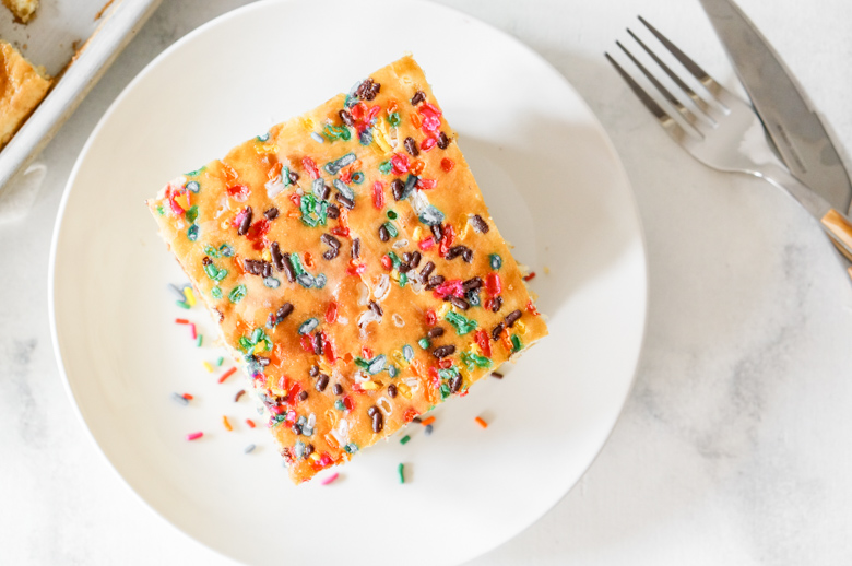 Sheet Pan Pancakes 4 Ways!  Make this sheet pan breakfast - chocolate chip, confetti, brown sugar, & strawberry - and get ready for rave reviews.