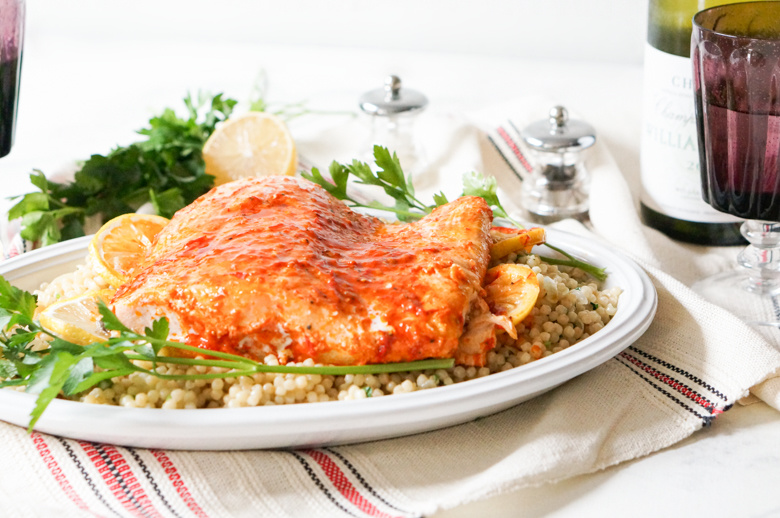 If you've been looking for an elegant dish that will impress your guests, try our Slow Roasted Harissa Salmon with Lemon Couscous. Baked in olive oil, the salmon stays moist and flaky, making it almost impossible to overcook!