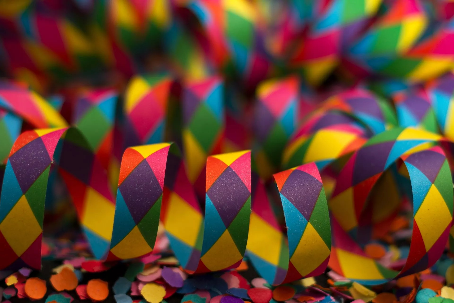 An up-close shot of colorful confetti and streamers