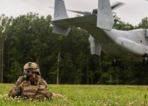 A Marine with Fox Company, 2nd Battalion, 8th Marine Regiment posts security after exciting the MV-22 Osprey during embassy reinforcement training at the Asymmetric Warfare Training Center at Fort A.P. Hill, Va., June 28, 2016, as part of a certification exercise for the unit's upcoming deployment in support of Special-Purpose Marine Air-Ground Task Force, Crisis Response- Africa. During the training, the unit learned the most effective way to handle situations involving violent local citizens and what it feels like to interact with a combative local populace. (U.S. Marine Corps photo by Sgt. Michelle Reif/Released.)