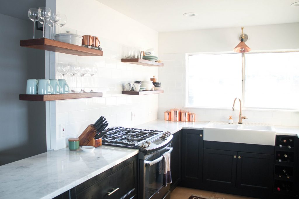 kitchen remodel with open shelving and modern marble countertops // via fortheindoorsy.com