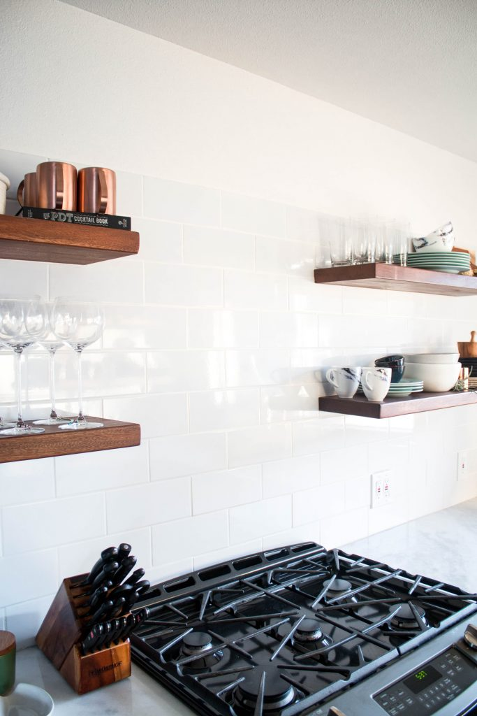 modern kitchen with open shelving and copper kitchen accents // via fortheindoorsy.com