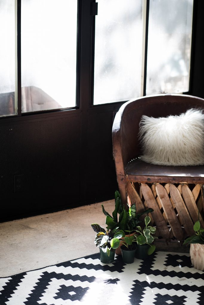 DIY Bohemian Sunroom Renovation // black and white sunroom with Mexican equipale chair