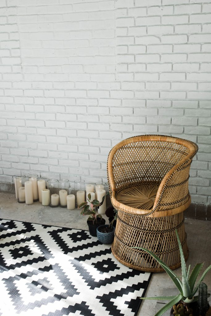 Sunroom Makeover // black and white sunroom with rattan chair