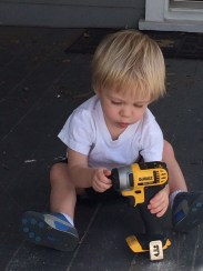 Levi playing with the drill.