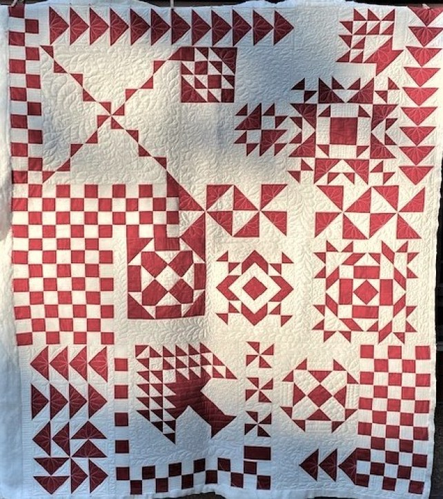 red and white patchwork quilt