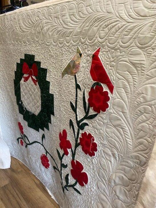 christmas wreath and cardinals