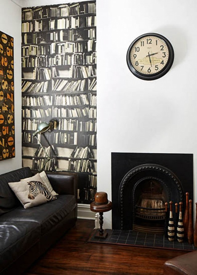 Wallpaper used as accent wall with book pattern