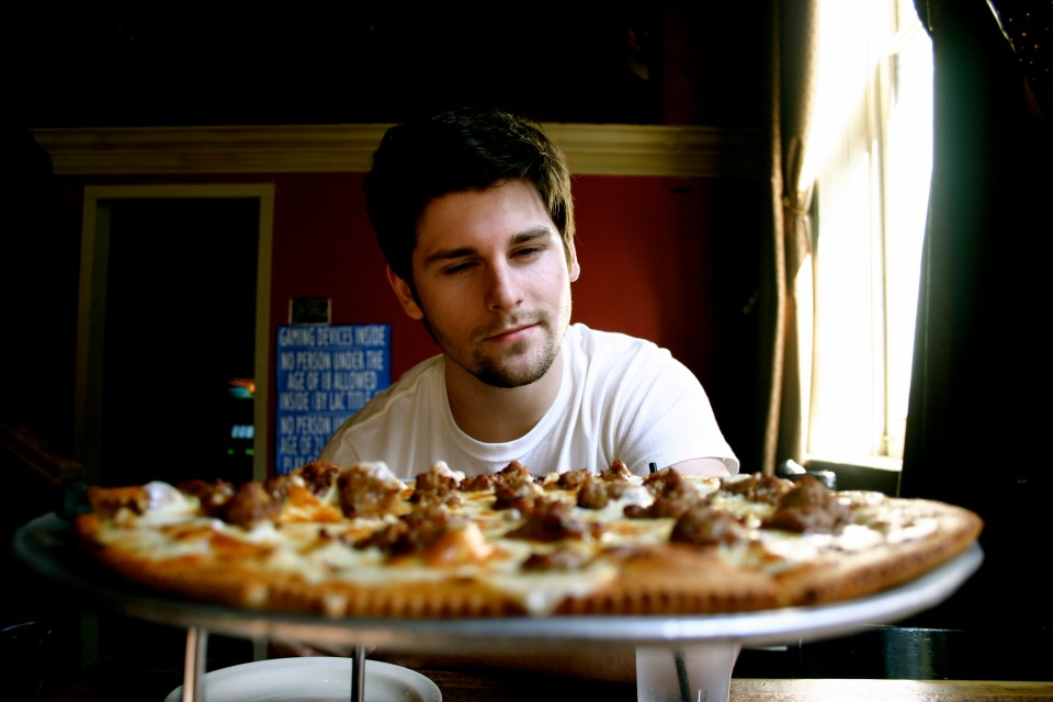 Alex and Our French Quarter Pizzeria Pizza