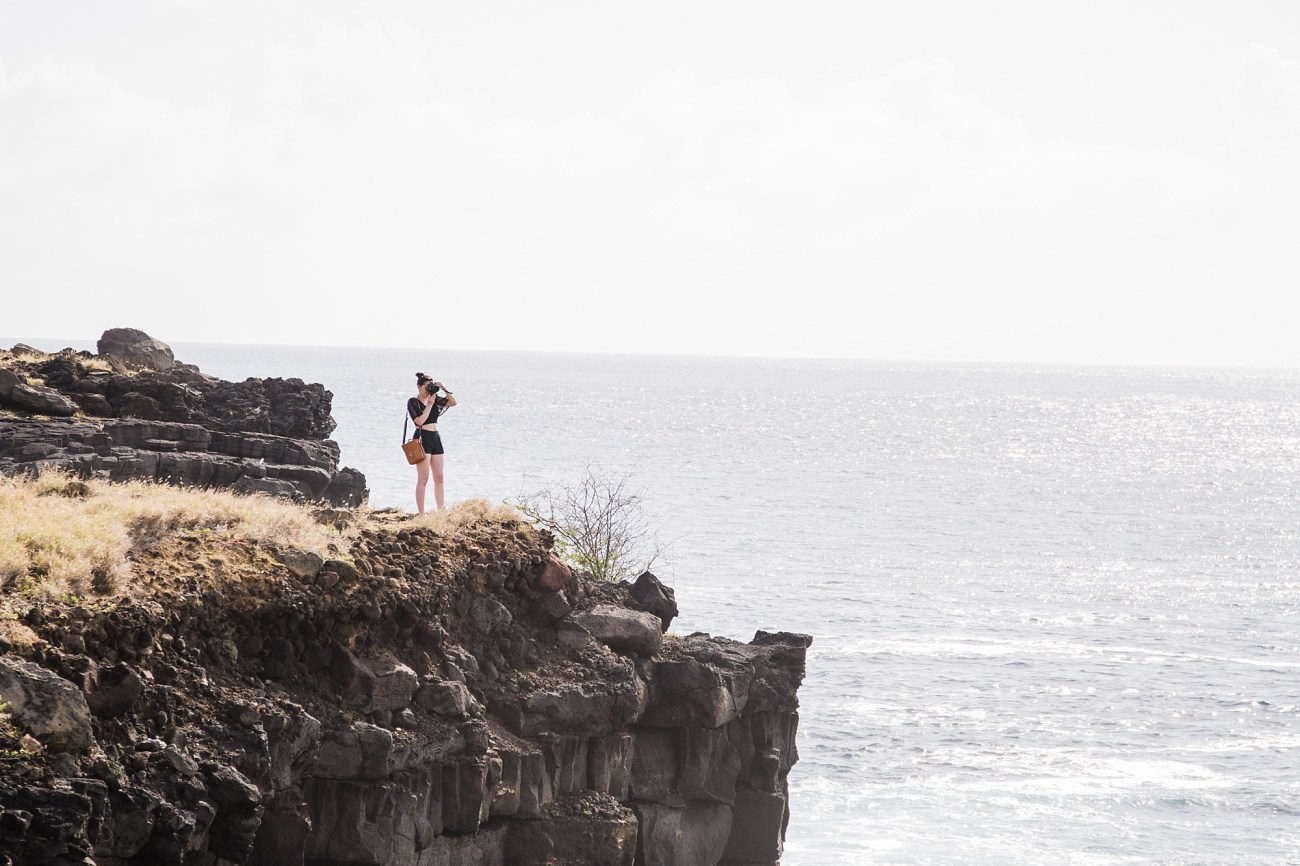 Photo of Laura Lango on Sea Cliff at South Point Park on the Big Island of Hawaii, taken by Devon Young of Forthright Photo