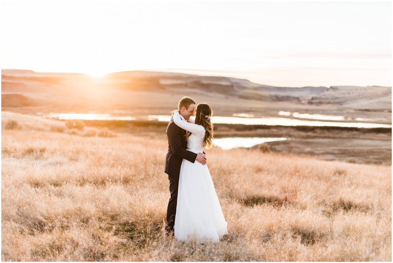 Photo of a bride and groom in a meadow at sunset by Forthright Photo