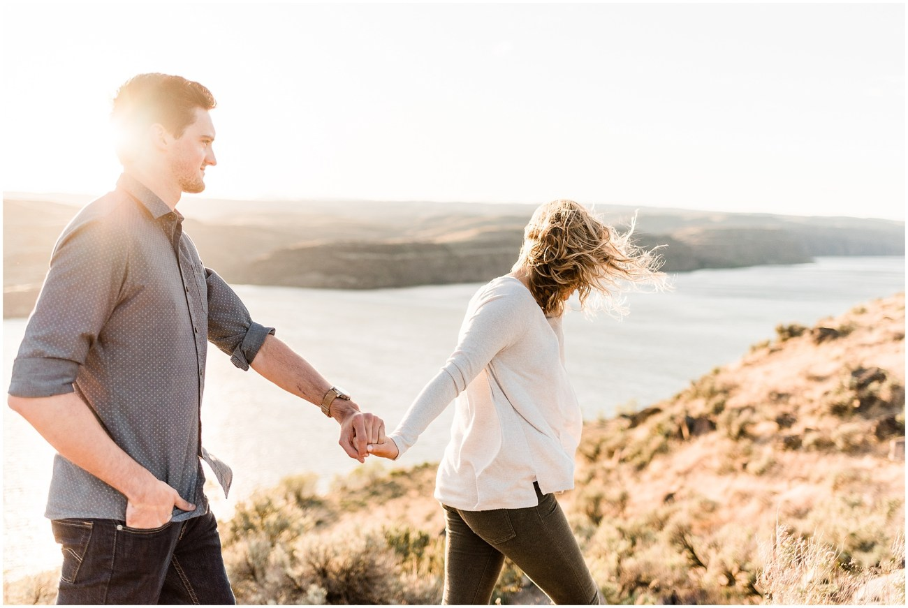 Photo of an engaged couple walking alongside the Columbia River Gorge in the Frenchman Coulee Recreation Area in Vantage WA, by Forthright Photo