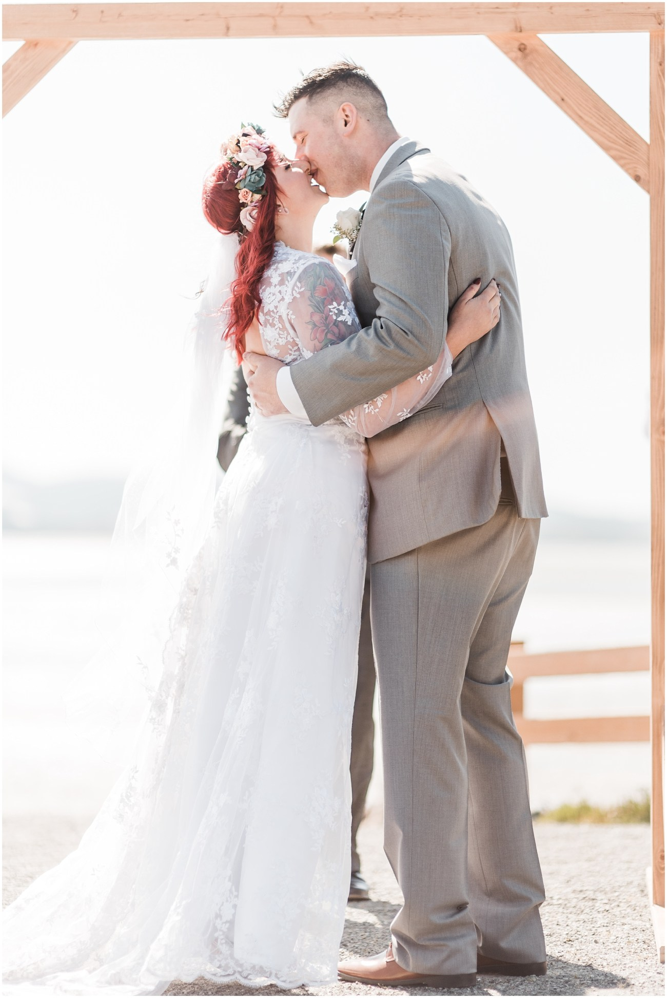 Photo of Bride and Groom kissing during their wedding ceremony at Bayview State Park