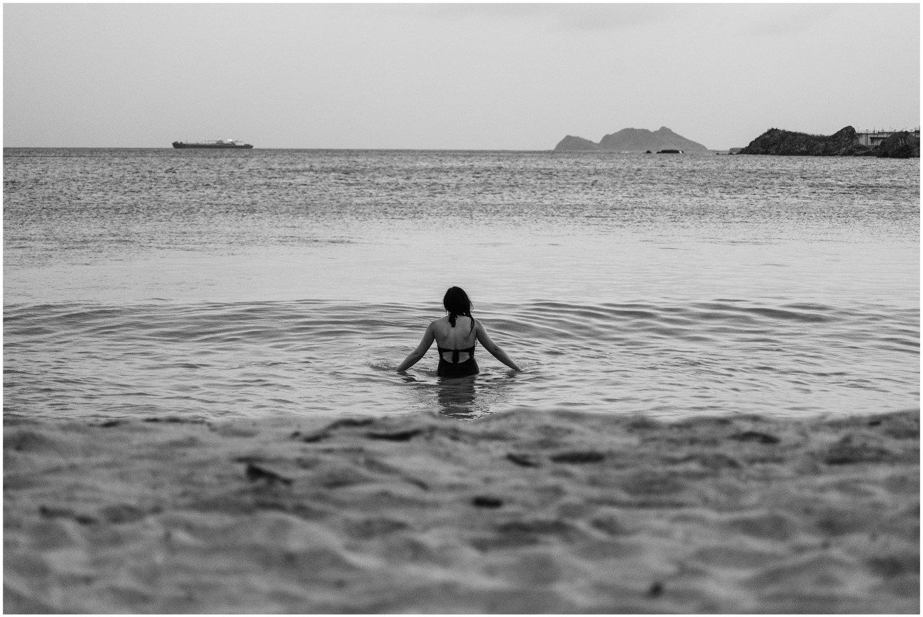Black and White photo of a woman swimming at Emerald Beach, St. Thomas, US Virgin Islands